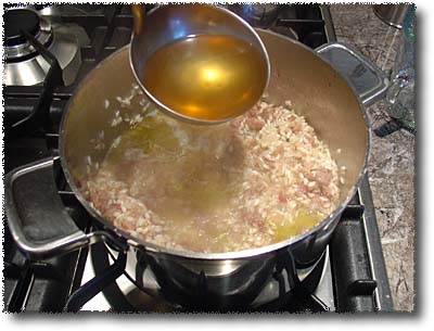 Adding Broth to the Sausage Risotto