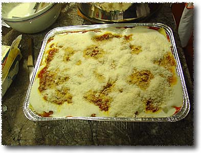 Making Lasagna: Sprinkle the Top With Grated Cheese