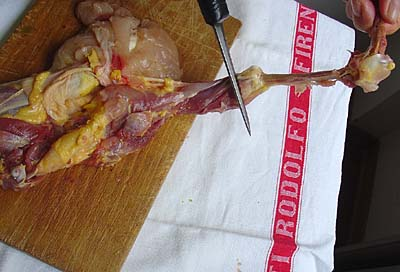 Boning a chicken: Cut the leg bones free