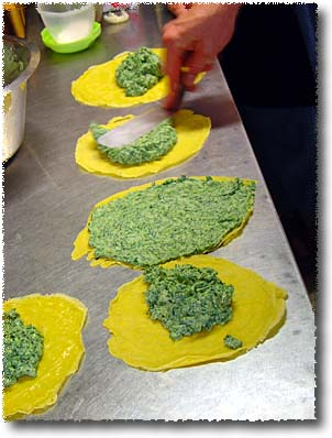 Making Crespelle alla Fiorentina: Spreading the Filling
